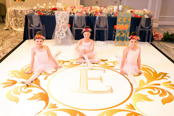 om dance floor - dancing flower girls - E'MAGNE Events & Co - North Carolina luxury wedding planner - branded logo - orange and navy blue wedding - cust