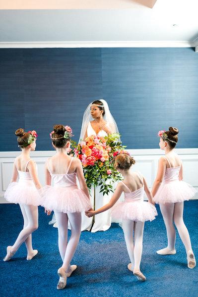 E'MAGNE Events & Co - North Carolina luxury wedding planner - branded logo - orange and navy blue wedding - bride and flower girls - ballerinas