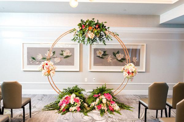 E'MAGNE Events & Co - North Carolina luxury wedding planner - branded logo - orange and navy blue wedding - moon gate - wedding ceremony structure