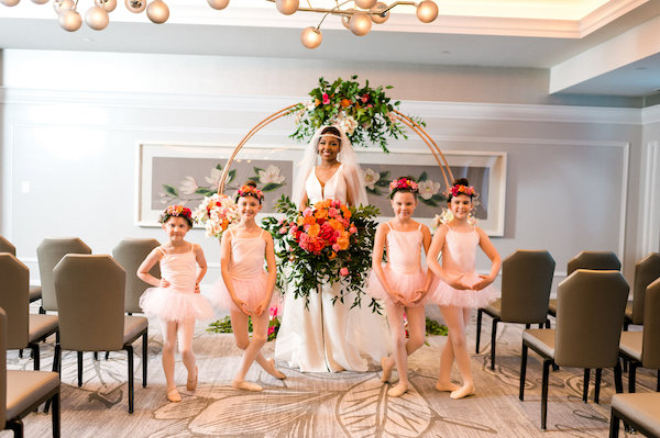 E'MAGNE Events & Co - North Carolina luxury wedding planner - branded logo - orange and navy blue wedding - bride with flower girls