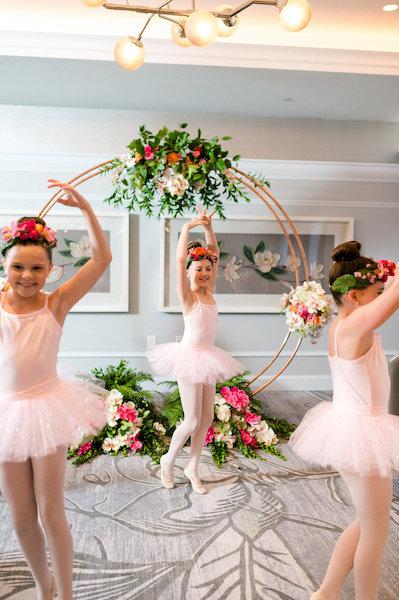 E'MAGNE Events & Co - North Carolina luxury wedding planner - branded logo - orange and navy blue wedding - flower girls dancing
