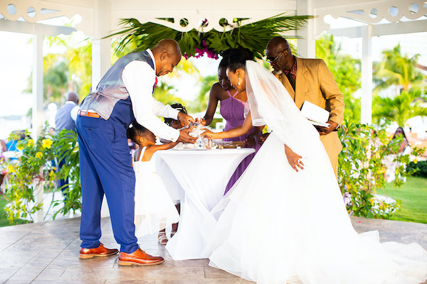 North Carolina destination wedding planner- Jamaican destination wedding - Moon Palace Jamaica- wedding gazebo - bride and groom - sand ceremony - sand ceremony with children - including your children in your wedding