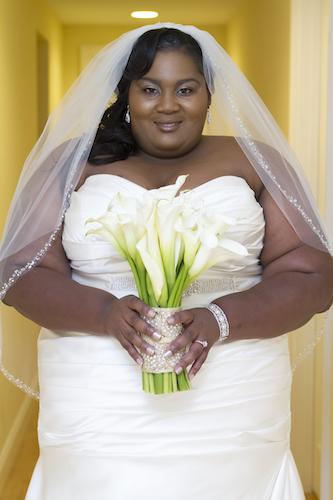 curvy bride - curvy black bride - bride carrying calla lily bouquet with crystal band - bride- bride with wedding bouquet - North Carolina wedding