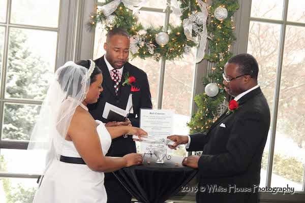 bride and groom exchanging wedding vows - black bride and groom exchanging wedding vows - winter wedding