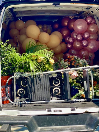 North Carolina Wedding planner, North Carolina Event Planner, E'MAGINE Events & Co, balloon decorations, North Carolina balloon decorations, car filled with balloons and flowers for an event