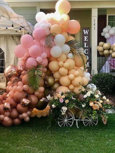 North Carolina Wedding planner, North Carolina Event Planner, E'MAGINE Events & Co, balloon decor, North Carolina balloon decorations, outdoor event with balloon decorations, bicycle with floral decor