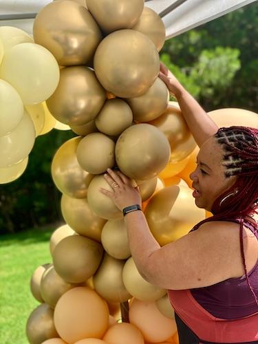 North Carolina balloon decor - balloon art for events - Shaunda working on a balloon creation - Shaunda Eggleston - E'MAGINE Events & Co
