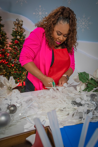 Shaunda Eggleston struggling with dull scissors on the set of The Design Network's show Sleighed