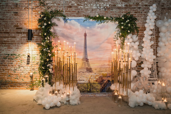 AParis themed backdrop with balloons and candles for a wedding proposal in Durham North Carolina