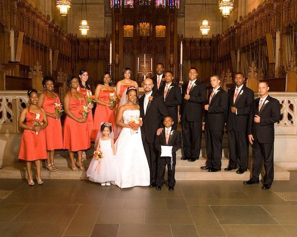large E'MAGINE Events wedding party posing for photos inside church